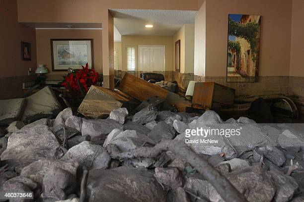 A home is filled with rocks and mud after debris flows smashed into homes as a powerful storm that has been lashing northern California moves...