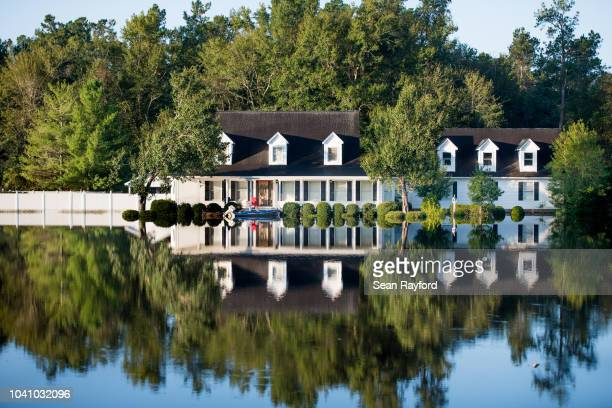 Home is inundated by floodwaters caused by Hurricane Florence on September 26, 2018 near Conway, South Carolina. Nearly two weeks after making...