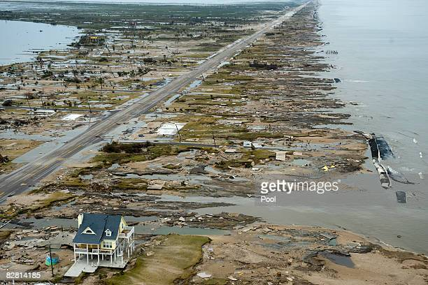 A home is left standing among debris from Hurricane Ike September 14 2008 in Gilchrist Texas Floodwaters from Hurricane Ike are reportedly as high as...