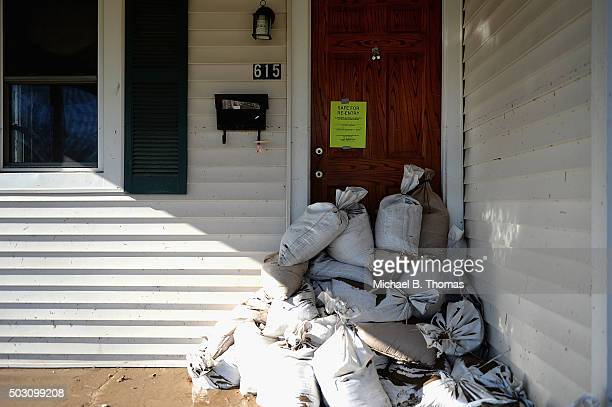 A home is marked safe for reentry after floodwaters receded on January 1 2016 in Pacific Missouri Pacific is one of many Missouri towns looking to...