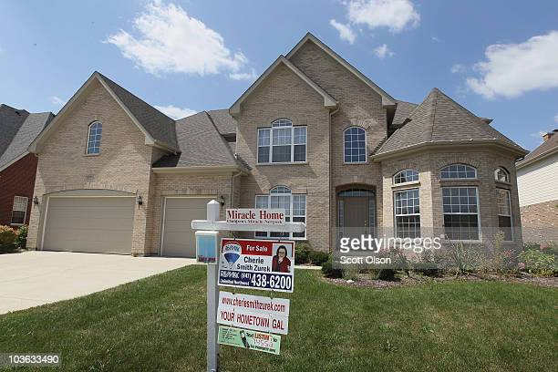 A home is offered for sale in the Coventry Creek subdivision on August 25 2010 in Kildeer Illinois The sales of new homes fell 124 percent in July...