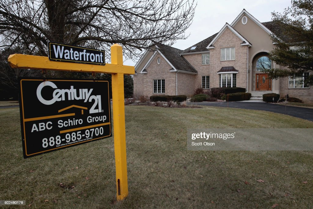 A home is offered for sale on February 21, 2018 in South Barrington, Illinois. January home sales experienced a sharp drop over the same period last year because of a shortage of modestly-priced homes available to first-time home buyers. Sales of homes priced below $100,000 fell 13 percent while sales of homes priced between $500,000 and $750,000 increased nearly 12 percent in January.