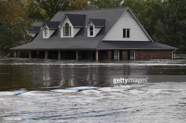 Home is seen inundated with water from cresting rivers from the rains caused by Hurricane Florence as it passed through the area on September 18,...
