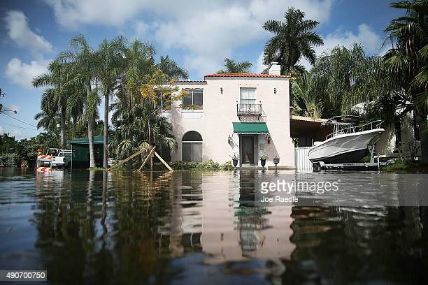 A home is seen surrounded by flood water caused by the combination of the lunar orbit which caused seasonal high tides and what many believe is the...