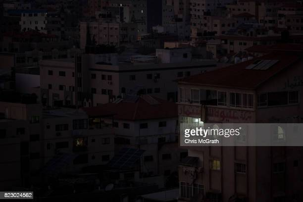 A home is seen with electricity on July 19 2017 in Gaza City Gaza For the past ten years Gaza residents have lived with constant power shortages in...