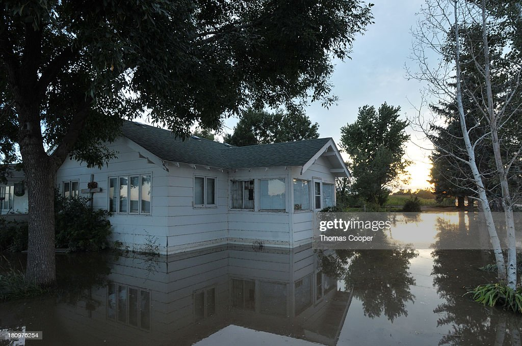 A home is shown inundated by flood waters September 17, 2013 near Evans, Colorado. Even as flooding subsides, many in the hardest hit areas of the state remain stranded by washed out roads and rushing creeks and without water and power.