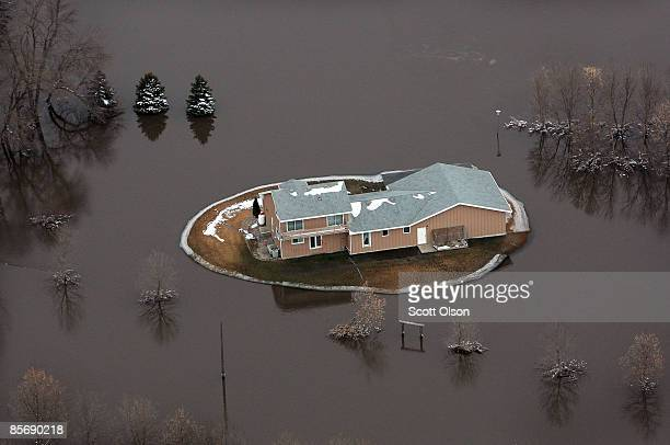 A home is surrounded by flood water from the Red River March 29 2009 near Fargo North Dakota As flood waters from the Red River began to recede in...