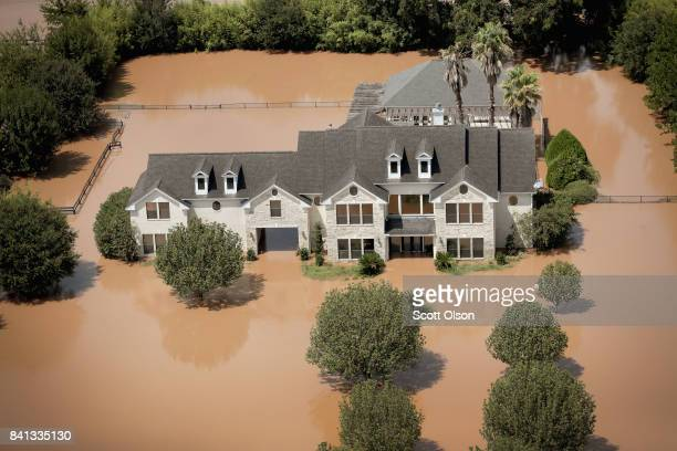 Home is surrounded by floodwater after torrential rains pounded Southeast Texas following Hurricane and Tropical Storm Harvey on August 31, 2017 near...