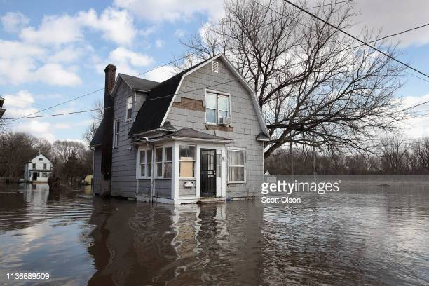 A home is surrounded by floodwater from the Pecatonica River on March 18 2019 in Freeport Illinois Several Midwest states are battling some of the...