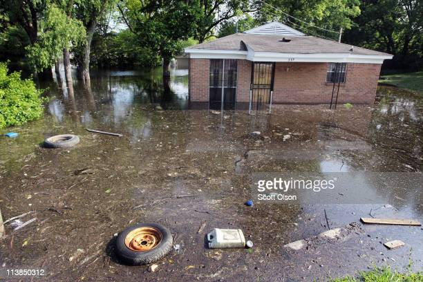 Home is surrounded by floodwater in the West Junction neighborhood May 8, 2011 in Memphis, Tennessee. Officials estimate about 1,300 homes are at...