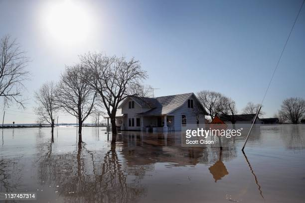 A home is surrounded by floodwater on March 21 2019 in Craig Missouri The town of Craig is completely surrounded by floodwater every building water...