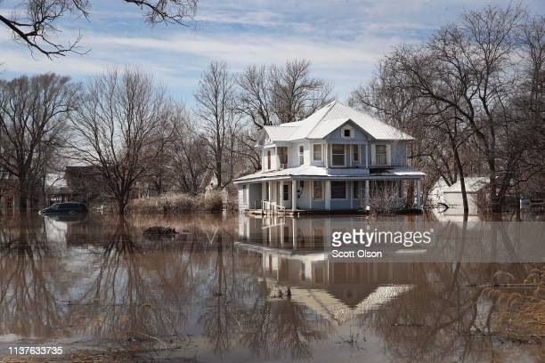 A home is surrounded by floodwater on March 22 2019 in Craig Missouri Midwest states are battling some of the worst flooding they have experienced in...