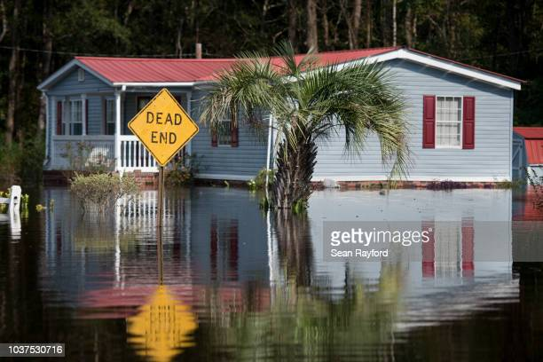 A home is surrounded by floodwaters caused by Hurricane Florence near the Todd Swamp on September 21 2018 in Longs South Carolina Floodwaters are...