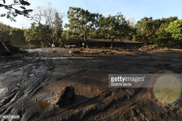 A home is surrounded by mud and debris caused by a massive mudflow in Montecito California January 10 2018 Search and rescue efforts intensified...