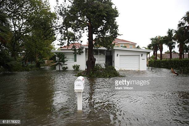 A home is surrounded in Hurricane Matthew's flood waters October 7 2016 on Port Orange Florida Hurricane Matthew passed the area offshore as a...