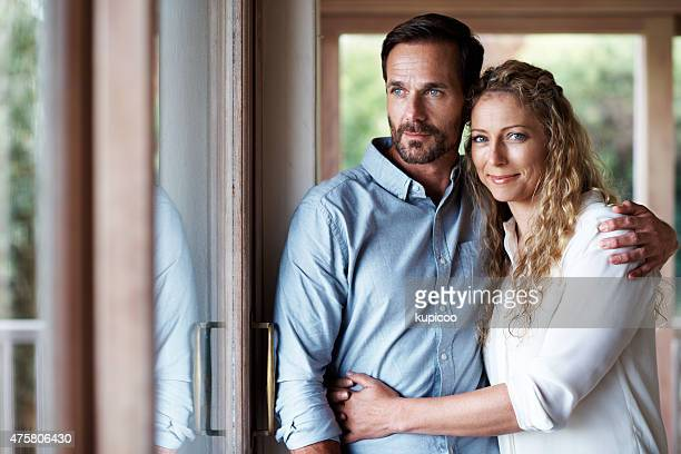 home is where your husband is - mid adult couple stock pictures, royalty-free photos & images