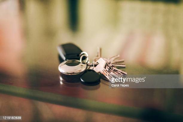 home keys on a glass table - car key stock pictures, royalty-free photos & images