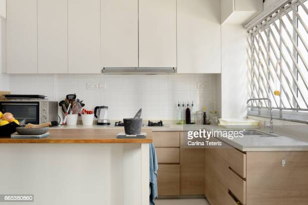 home kitchen with white cabinets and an island - 台所 ストックフォトと画像
