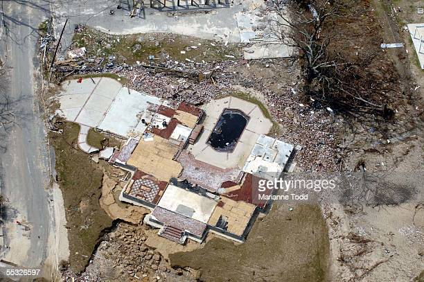 A home lies in ruins flattened by Hurricane Katrina along US Highway 90 September 9 2005 in Pass Christian Mississippi Damage from the storm is...
