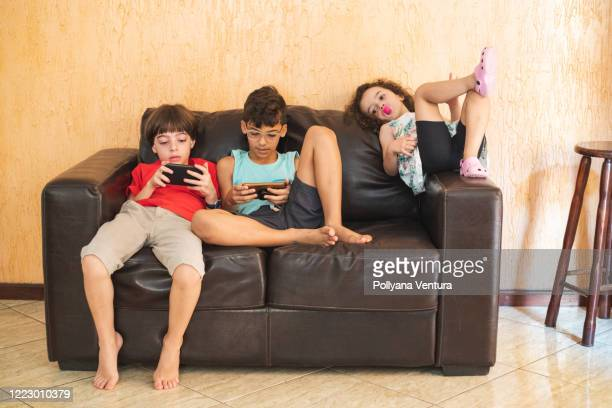 home life - two seater sofa stock pictures, royalty-free photos & images