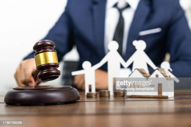 home loan law concept,home insurance law concept,model of house with gavel and money on the table. top view. space for text. - auction stock pictures, royalty-free photos & images