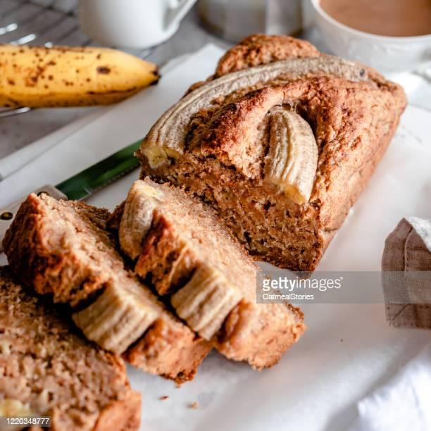 home made banana bread and a cup of tea - banana loaf stockfoto's en -beelden