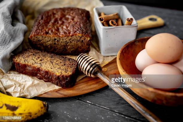 home made banana bread rustic flat lay fresh ingredients honey eggs - banana loaf stockfoto's en -beelden