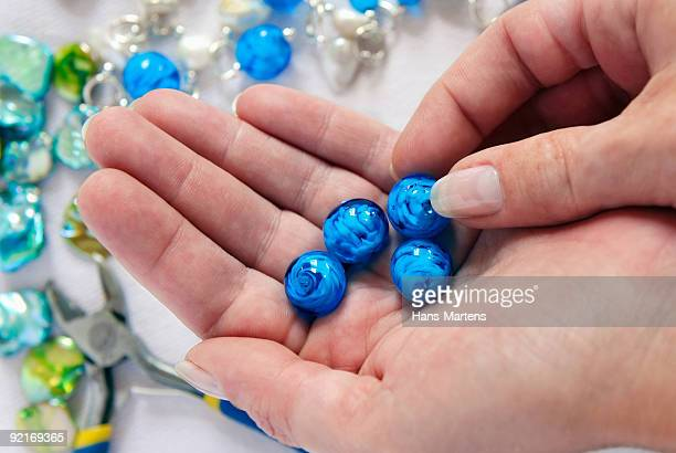 home made bead jewellery making as a hobby - bead stock pictures, royalty-free photos & images