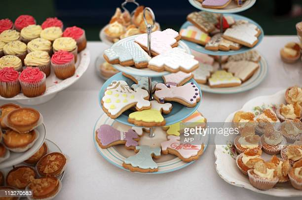 Home made cakes stand on display at a Tea in the Park event in Kate Middleton's home village of Bucklebury Berkshire on April 29 2011 AFP PHOTO /...