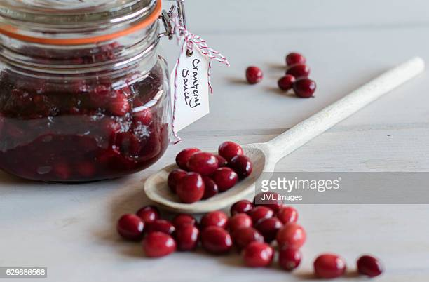 Home made cranberry sauce in jar with tag (label)