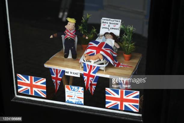 A home made display is seen in a shop front congratulating Prime Minister Boris Johnson and Carrie Symonds on the birth of their child at...