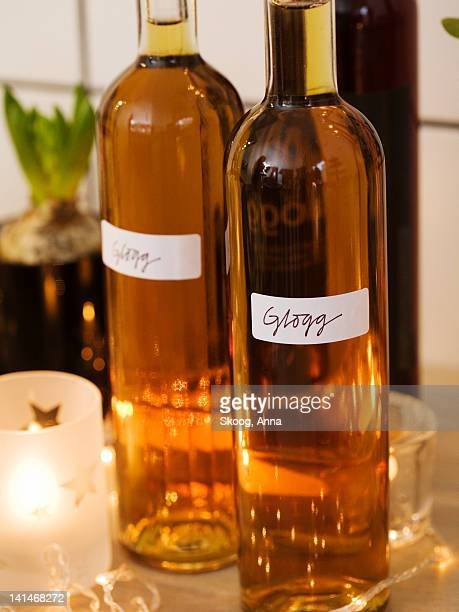 Home made mulled wine in bottles, close-up