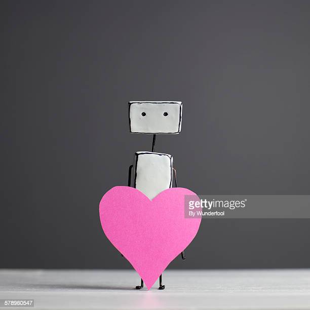 Home made robot holding a paper heart