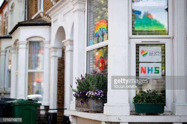 Home made signs of support of the NHS and care workers are displayed in the windows of people's homes in Walthamstow, north London on April 17 during...