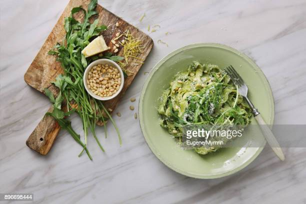 home made tagliatelle with basil and rocket pesto - mottled skin stock pictures, royalty-free photos & images