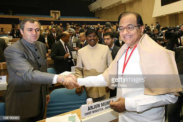 Home Minister P Chidambaram shakes hands with J K Chief Minister Omar Abdullah as Jharkhand CM Arjun Munda looks on at the Chief Ministers'...