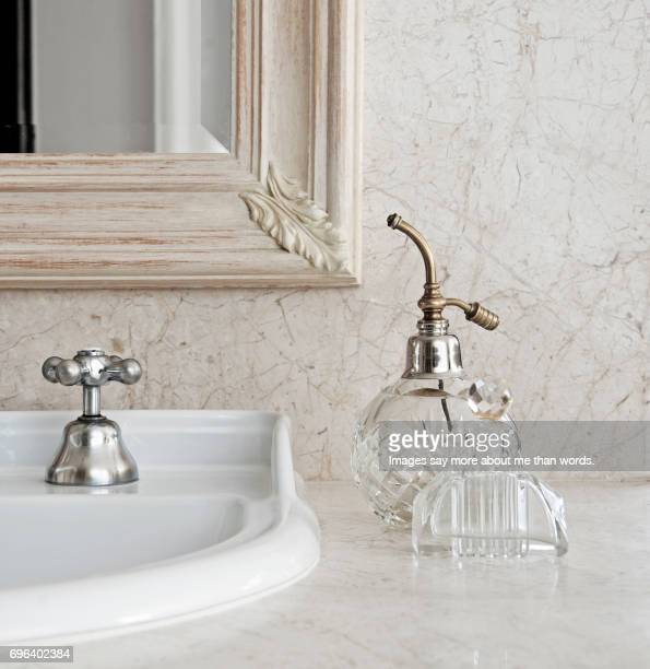 home moments - bathroom countertop with old perfume bottles. - grooming product stock photos and pictures