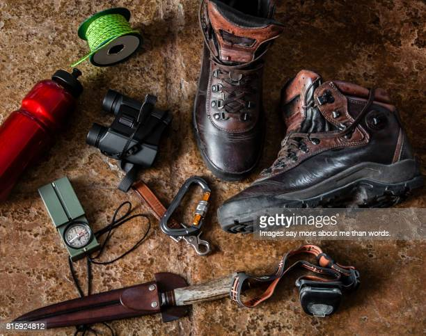 home moments - boots and hiking equipment - still life - utility knife stock photos and pictures
