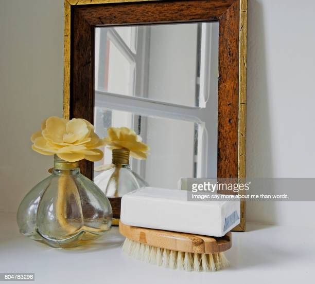 home moments - vanity with mirror, body brush, soap and scents. - dressing table stock photos and pictures