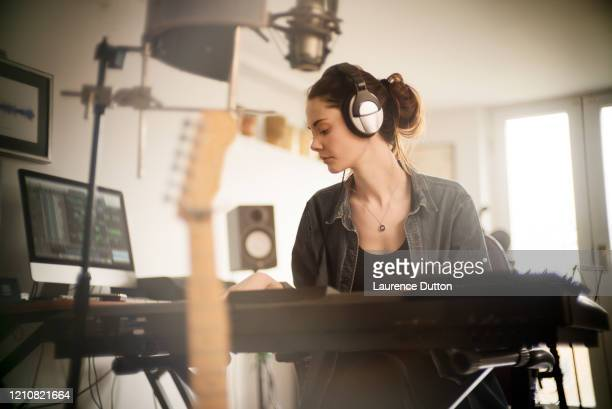 home music woman keyboard - singer songwriter stock pictures, royalty-free photos & images