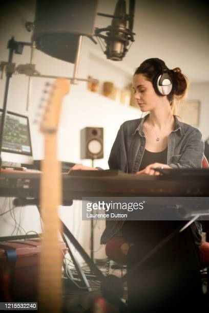 home music woman keyboard vertical - singer songwriter stock pictures, royalty-free photos & images