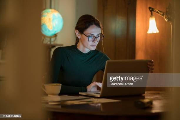 home night work woman study - urgency stock pictures, royalty-free photos & images