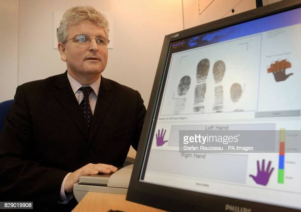 Home Office Immigration Minister Des Brown has his finger prints mapped on equipment being tested for the new biometric identification card...