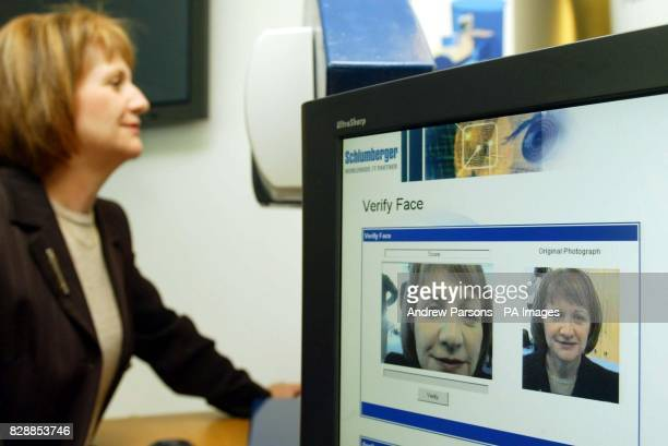 Home Office minister Beverley Hughes demonstrates the Biometric testing equipment used to enrol people by measuring their facial parameters taking a...
