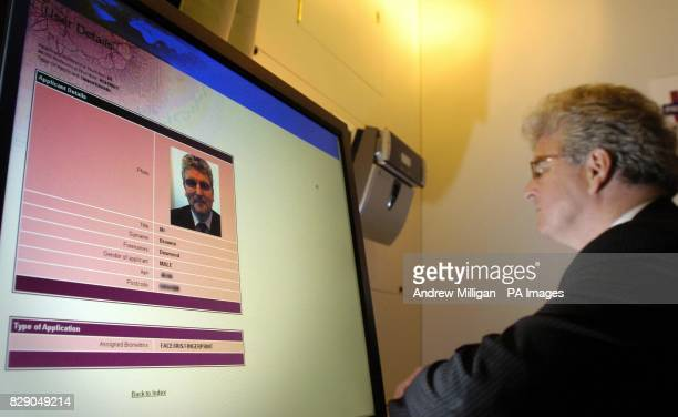 Home Office Minister Des Browne, MP having a Biometric identity card made at the DVLA office in Glasgow. The Government intends to introduce a...