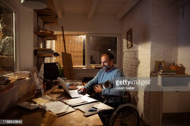 home office - persons with disabilities stock pictures, royalty-free photos & images