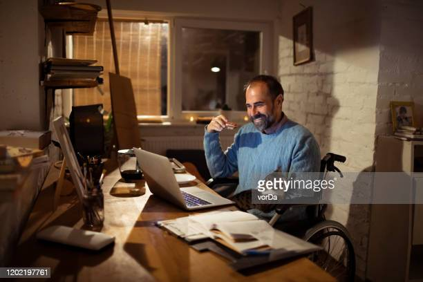 home office - surfing the net stock pictures, royalty-free photos & images