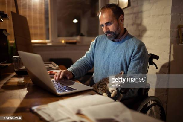 home office - wheelchair stock pictures, royalty-free photos & images
