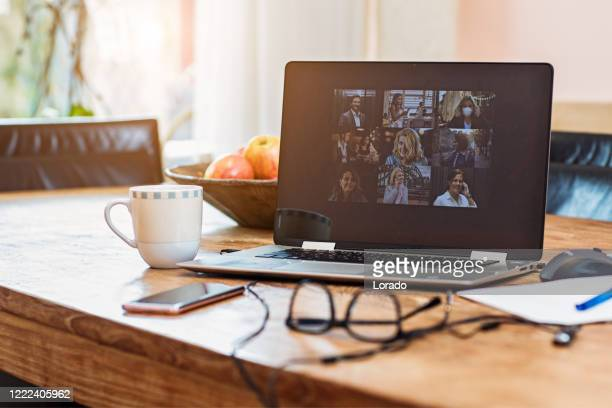 home office set up for webinar and teleconference - distant stock pictures, royalty-free photos & images