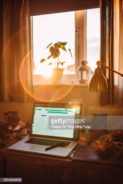 home office setting with opened laptop placing on the desk in the study at home - modern stock pictures, royalty-free photos & images
